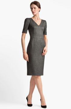 Darts above and below the natural waist highlight the feminine figure in a smart wool-blend dress woven in a menswear-inspired herringbone tweed. Color(s): charcoal. Brand: DolceGabbana. Style Name: DolceGabbana Stretch Herringbone Dress. Style Number: 679458.