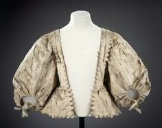 FCBTC / Bodice, circa 1630-40 -  This punched-silk bodice was made to be worn with a long stomacher. 17th century stomachers were longer than 18th century stomachers and were often done in contrasting rather than matching designs.