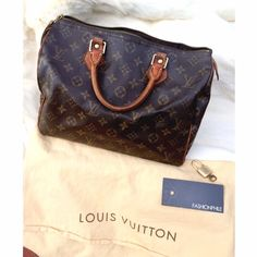 Authentic Louis Vuitton Speedy 25 Louis Vuitton monogram canvas Speedy 25 + dust bag + lock and key. Used condition with dark patina and cracks on coated canvas through the stitching near the zipper. Brass hardware fully intact and freshly polished. Zipper pull leather (not hardware) is fragile but still fully attached. All four bottom corners have scuffs. Purchased from Fashionphile. Red glossy bag shaper in bottom. TH1003 offers welcome, no trades. Please keep offers reasonable. Louis…