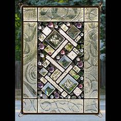 """Edel Byrne creates this artistic, Clear Geometric Border Stained Glass. This piece can be hung vertically or horizontally. Handmade in the USA.Each window panelis unique and holds Edel'ssignature style of """"lace leadwork"""".Mixing lead and glass stones, Edel creates a style that could only be called medieval expressionism. Using a large palette of different shapes of colored glass and bevels, panels are individually laid out on the work table.Free Ground Shipping* Sizes and Prices Available…"""