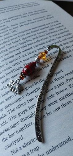 Never forget your page again with this beautiful Elephant Bookmark, lovingly handmade in Northern Ireland with silver-tone, glass and ceramic beads complimenting a Tibetan style marker. The elephant is said to be a symbol of good luck, it is also said that elephants never forget, This bookmark Elephants Never Forget, Ceramic Beads, Good Luck, Organza Bags, Northern Ireland, My Images, Markers, My Design, Beaded Bracelets