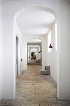 hallway with vintage lighting and arched doorways