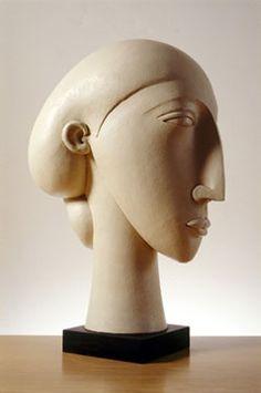 'cream head' by British ceramic sculptor Patricia Volk. 62 cm tall. via the artist's site