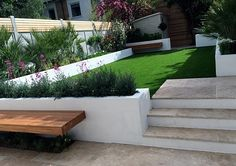 Artificial grass planting London travertine paving Balham Clapham Battersea Contact anewgarden for more information Back Gardens, Small Gardens, Outdoor Gardens, Back Garden Design, Modern Garden Design, Brixton, Outdoor Topiary, Tiered Garden, London Garden