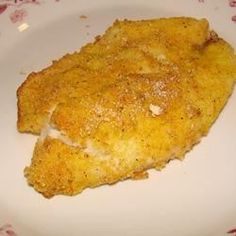 A spicy breading gives a crunch to these oven-fried catfish fillets.