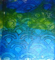 A print from my last Gelli session - Kris Zorko. Shades of blue and green with traces of gold on deli paper. Fish scale stencil.