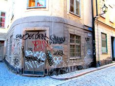 Street Art of North: Klotter. Graffiti, Street art is vandalizing, destroying in Stockholm Old Town