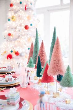 We know that traditonal holiday colors are red and green, but a moment of ooh-ing for these pint-size, cotton-candy pink and turquoise blue Christmas trees, please. These bright, unexpected colors add a refreshing new spin on the traditional foliage.