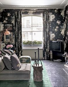 Delve into your dark side with a Gothic-inspired black floral wallpaper.