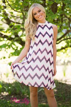This blazingly vibrant chevron dress will stand out in a crowd! Featuring a hot pink and black chevron pattern against a white background, you'll look fabulous while dancing the night away or celebrating with family and friends! With the halter top and the sleeveless cut, it's perfect for warm summer nights.