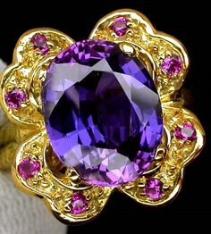 Beautiful purple sapphire 925 solid sterling sil ver ring with a 14K gold yellow coating.