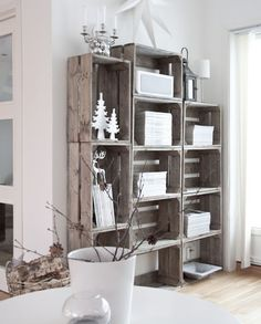 Talk about recycling! We love how these rustic storage boxes have been used to build a creative yet functional bookcase. Accessorized with a few clever pieces, they will look great in most rustic, eclectic or industrial interiors.