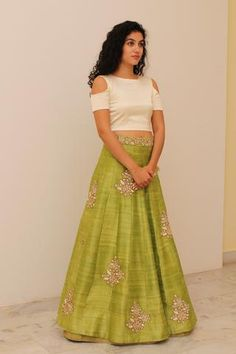 Beige crop top with green embroidered lehenga. Delivery will require approximately 4 weeks as the product is customised. Once your order is Lehenga Designs, Indian Attire, Indian Wear, Ethnic Fashion, Indian Fashion, Indian Dresses, Indian Outfits, Blouse Lehenga, Silk Lehenga