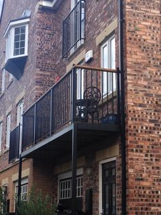 Walk out style balcony with ornate metal railings powdercoated black. Supplied and installed in York.