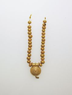 Etruscan necklace with a bulla and gold beads C.400BBC Tuscany Agriturismo Giratola