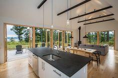 Modern cabin inspired by Danish design on the Hood Canal, Washington Light across the beams Best Kitchen Design, Casa Loft, Light Hardwood Floors, Pine Floors, Forest Cabin, Earthship, House And Home Magazine, Architect Design, Modern House Design