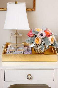 Metallic tray side table with cheery flowers and matching white and gold theme