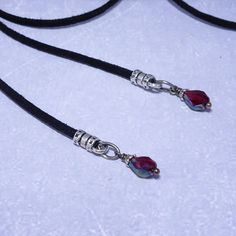 Versatile Gothic blood vial pendant lariat choker necklace that can be worn different ways, including as a wrap bracelet. Created with a teardrop glass bottle filled with fake blood, finished with black suede cord and extension chain ending in a beautiful blood red crystal. Vampire
