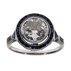 An early 20th Century Platinum, Diamond and Sapphire cluster Ring
