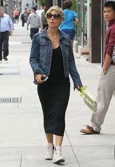 Elsa Pataky exuded a sporty aesthetic in a black tank dress, high-top sneakers, and a denim jacket while hitting the streets of Beverly Hills.