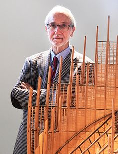 Italian architect Renzo Piano poses near a model of the cultural center Tjibaou of Noumea on November 10, 2015 in Paris. AFP PHOTO / DOMINIQUE FAGET.