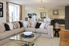 Walls are painted in neutral Matt Calico, white smoothly plastered ceilings are and enhanced by a contemporary styled cornice, leaving a rich first impression. Kings Home, Property Development, Sofa, Couch, Cornice, Ceilings, Neutral, Walls, Contemporary