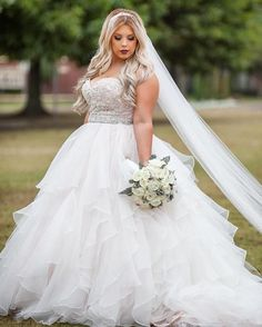 Beautiful bride @brittanyaldridgeartistry looked stunning in our 2815!  Photo @kriea Dress: @pompandpageantryokc #morilee #madelinegardner #dresscometrue #bride #realbride #ruffles #ballgown #blush #wedding #dress #bridalinspo #veil #inspo #love