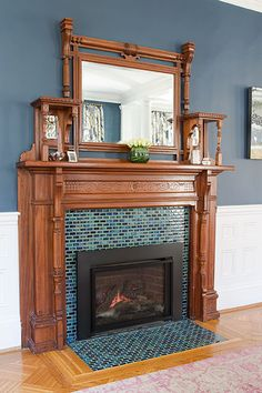 An antique mantel and a newly installed colorful tile surround give this existing dining room fireplace—outfitted with a gas insert—an entirely fresh look.