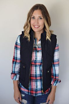 Fall Outfit - plaid shirt with navy puffer vest and crystal necklace.
