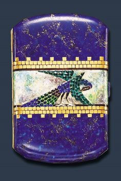 Cigarette case, textured blue, green and brown enamelled peacock against a mottled green and mauve enamelled band, within gold brick motif borders, blue and gold background, and push-piece, the reverse of similar design, mounted in 18k gold, Van Cleef and Arpels, circa 1925