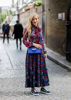 The Fashion Crowd Are Brightening Up Their Winter Wardrobes With Florals Dress it Down with Lace Up Trainers and a Bright Bag