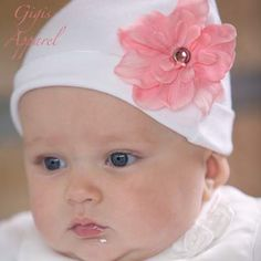 Adorable white soft baby hat with removable flower accessory.  GigisApparel