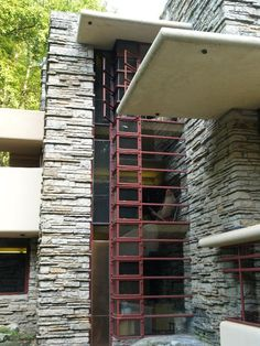 Fallingwater's soaring vertical column of glass rises more than three stories, creating a visual and literal anchor for the cantilevered floors and the terraces that extend them further. - Frank Lloyd Wright