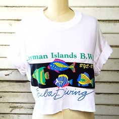 Vintage Crop Tee! Vintage crop tee with Caymen Islands graphic. 100% cotton tag reads XL. Measures 44 inches across chest, 16 inches from shoulder to hem Vintage Tops Crop Tops