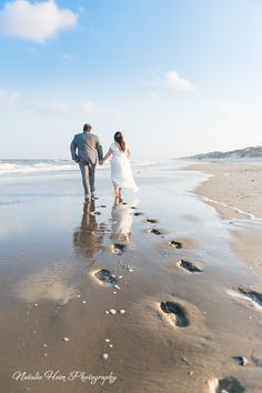 Beach wedding Bride and Groom portrait. Footprints in the sand.  www.natalieheimphotography.com