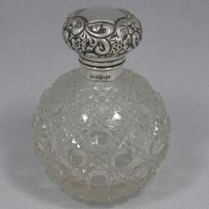 Antique Edwardian sterling silver and hand-cut crystal table scent bottle