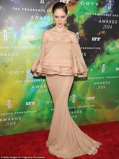 Coco Rocha in a daring drapery-inspired gown at the Fragrance Foundation Awards http://dailym.ai/1pcHgs5