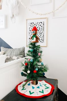 table top christmas tree with felt ornaments for a kid's room