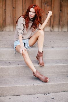 I love the muted basic clothes contrasting with the vibrant red hair.....beautiful without trying