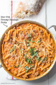 One Pot Creamy Sausage Pasta {with VIDEO RECIPE!} - Smells Home - Creamy Sausage Pasta from a Pot: A super simple irresistible pasta pot dish filled with spicy sausage and a silky tomato cream sauce. One Pot Creamy Sausage Pasta {with VIDEO RECIPE! Creamy Sausage Pasta, Sausage Pasta Recipes, Creamy Pasta Recipes, Italian Sausage Pasta, Sweet Sausage Recipes, Pasta With White Sausage Sauce, Cream Recipes, Pasta With Tomato Cream Sauce, Recipes With Pasta Sauce