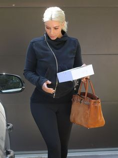 Reality star siblings Kourtney and Kim Kardashian stop to visit a friend's house in Beverly Hills, California on March 19, 2015, Kourtney is back to handling all of the parenting duties while her partner Scott Disick is in rehab.