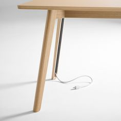 Solem table hides cables in its legs.