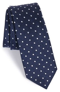 Such a charming navy blue tie. The white polka dots add a little bit of flare without going over board. A closet staple.