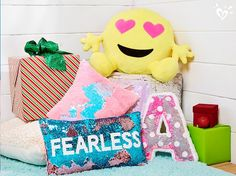 Flip sequins and bright hues add so much personality to her pillows.