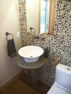 Small bathroom solutions - love the pebble tile wall. Diy Bathroom Decor, Bathroom Wall, Small Bathroom, Wall Tile, Basement Bathroom, Bathrooms, Eclectic Bathroom, Stone Bathroom, Basement Stairs