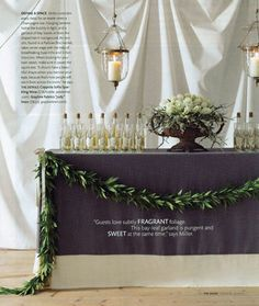 Hang sheets or fabric over a wall for a quick, elegant fix... use real greens, line up bottles... this is gorgeous.