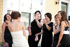 """Omigawd!! ... My bra is gone!!""  While adjusting, my sister peered inside the front of her dress to find that her strapless bra and shimmied it's was down to her waist.  Charla.ca Photography"