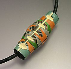 Polymer clay bead, carved, by Jana Roberts Benson