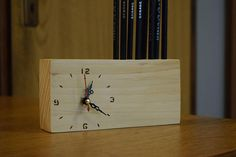 Desk clock with pencil holders Desk clock made out of wood with eight holders for pencils. Wood is high 9.5cm/3.74in, thick 4cm/1.57in and the lenght is 18cm/7.08in. The dial for clock is made with pyrography (wood burning). Radius of holes for pencils is 0.9cm/0.35in Dimensions of