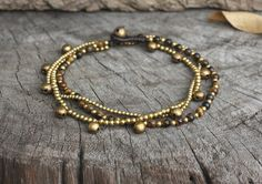 Hey, I found this really awesome Etsy listing at https://www.etsy.com/listing/179826873/tiger-eye-brass-bell-chain-anklet